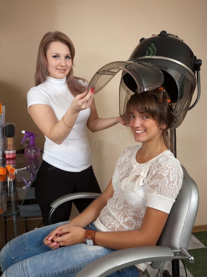 Hairdresser working with hair dryer royalty free stock photos