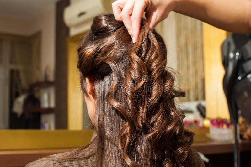 At hairdresser. Young woman hairdo at hairdressing salon royalty free stock photography