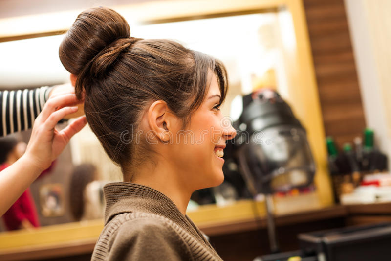 At hairdresser. Young woman hairdo at hairdressing salon royalty free stock photo