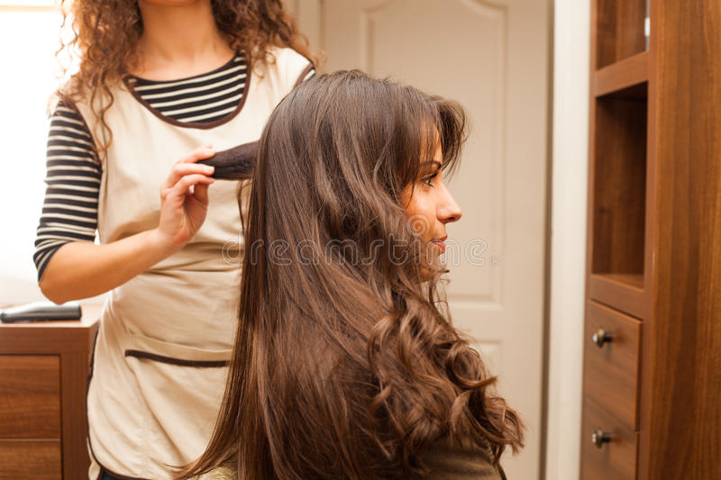 At hairdresser. Young women hairdo at hairdressing salon stock image