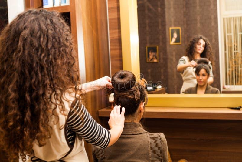 At hairdresser. Young women hairdo at hairdressing salon stock photos