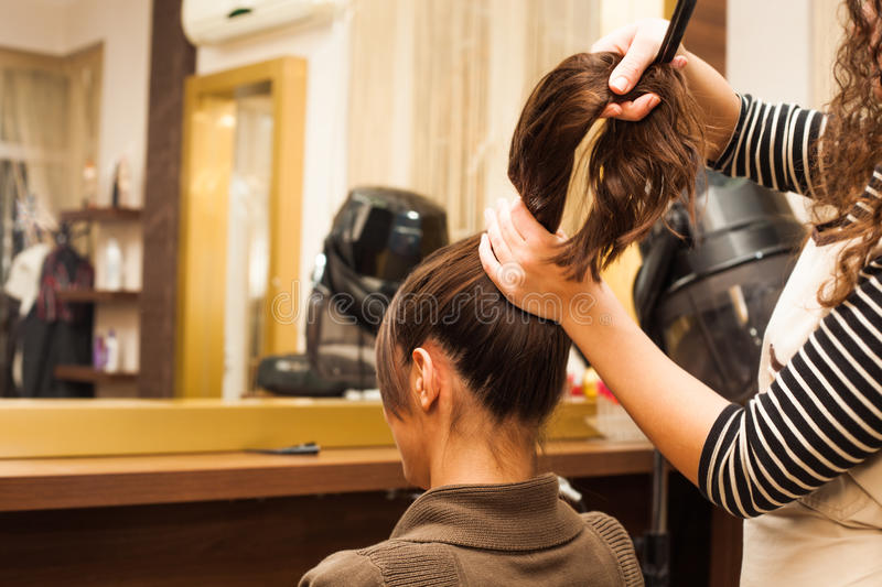 At hairdresser. Young women hairdo at hairdressing salon royalty free stock photos