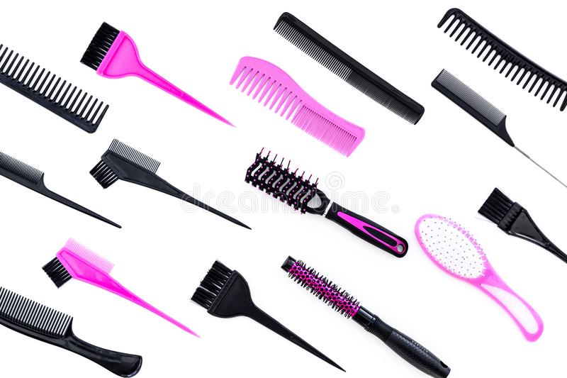 Hairdressing tools. Pattern with various combs and brushes on white background top view royalty free stock images