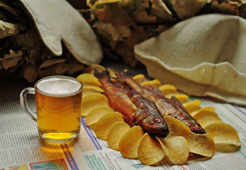 Hairdryer -啤酒,鱼,筹码 图库摄影