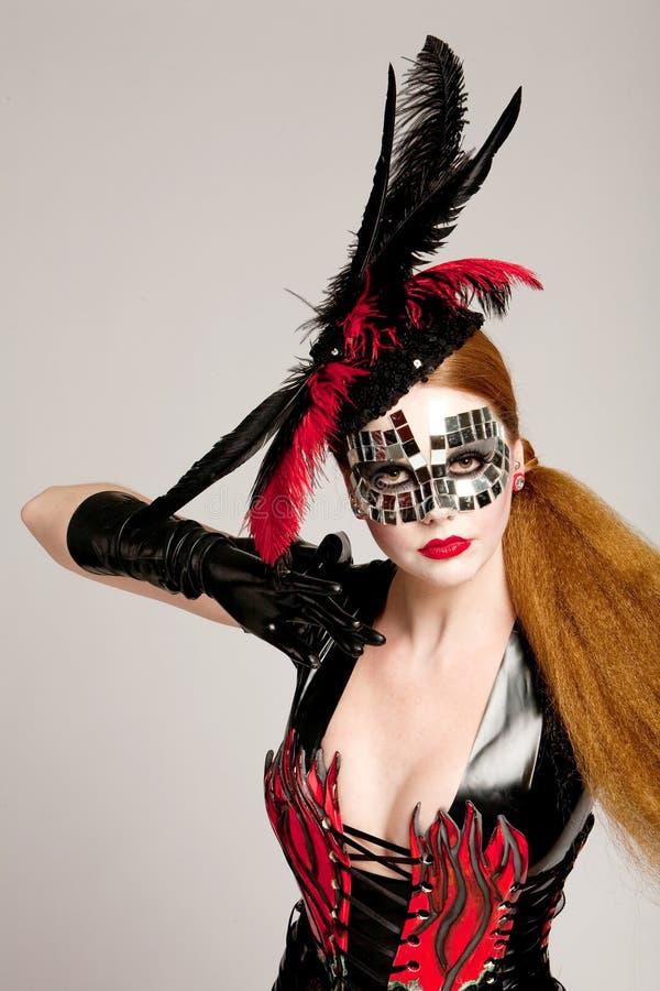 haired lång maskeringskvinna arkivbilder