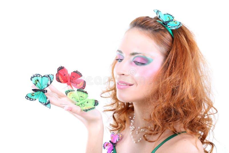 haired röd kvinna för fjärilar arkivbild
