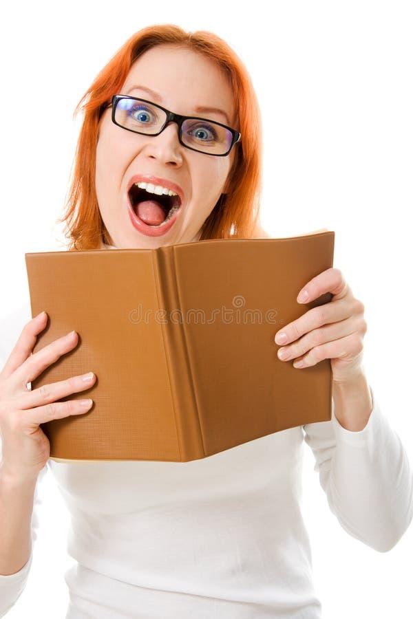 haired rött skrika för bokflickaexponeringsglas royaltyfria bilder