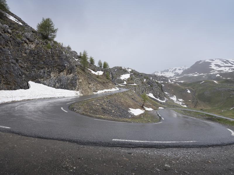 Hairpin bend in road to col de la bonette in alpes de haute provence royalty free stock photography