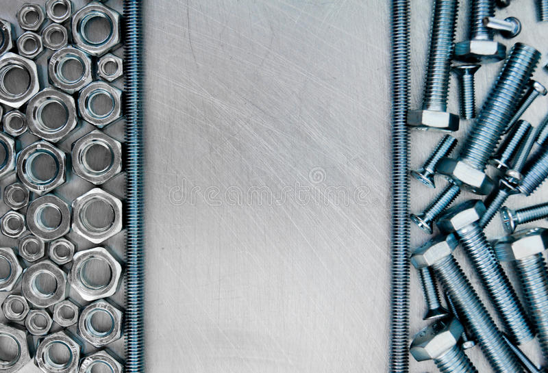 Hairpin and other fixing elements on the scratched. Metal working tools. Frame metal style. Hairpin and other fixing elements on the scratched metal background stock images