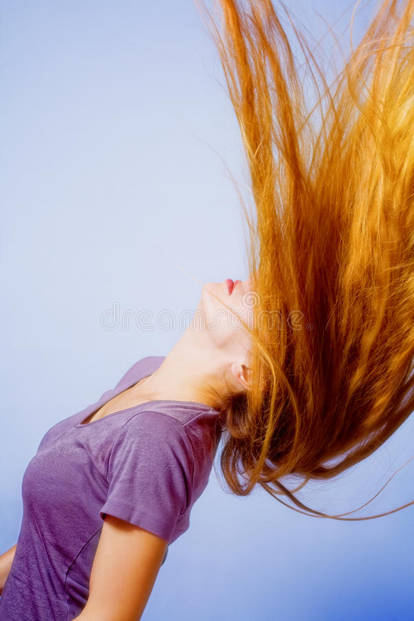 Hairstyle action - woman with long hair in motion stock photo