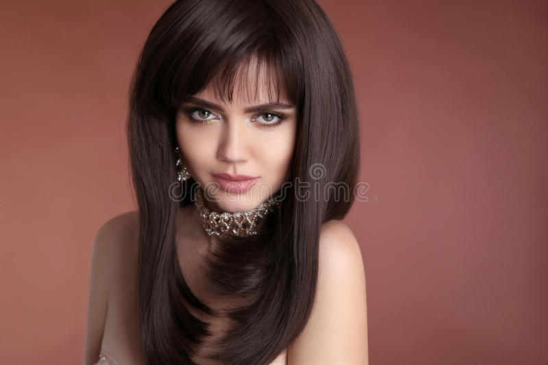 Hairstyle. Beauty portrait of brunette female face with makeup, stock photography