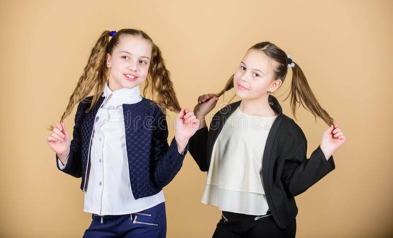 Hairstyle for female. Cheerful friends made same hairstyle for fun. We look like sisters. Best friends forever. Long stock photography