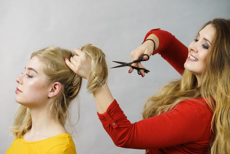 Woman with scissors ready to hair cutting royalty free stock images