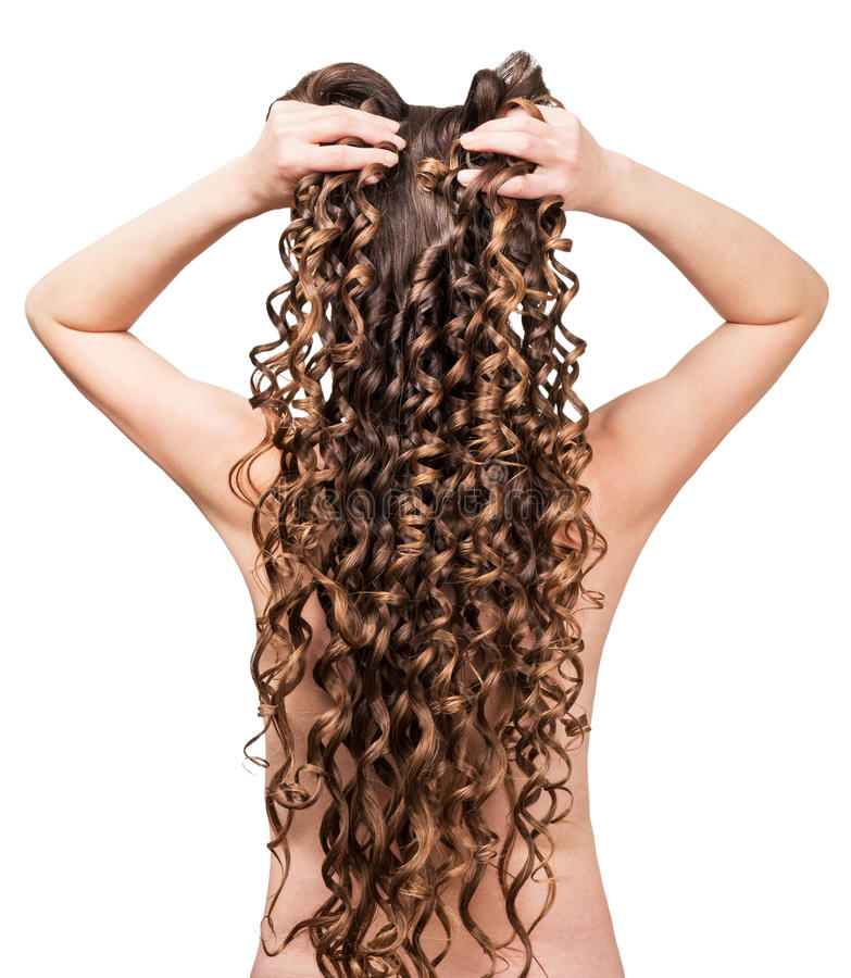 Hairstyle of long brown curls from behind isolated on white. royalty free stock photos