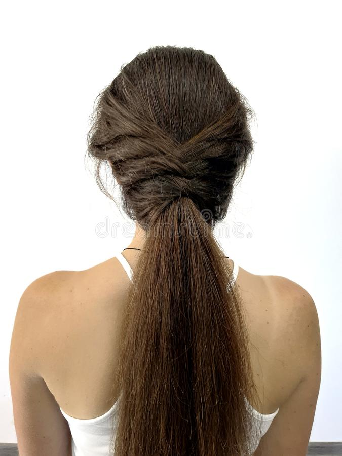 Hairstyle on long hair, braiding royalty free stock photography