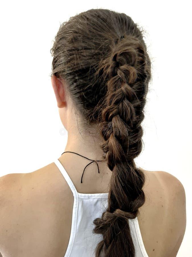 Hairstyle on long hair, braiding stock photos