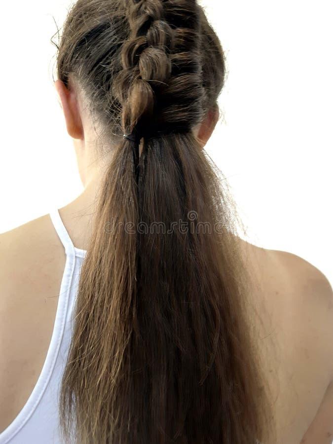 Hairstyle on long hair, braiding stock image