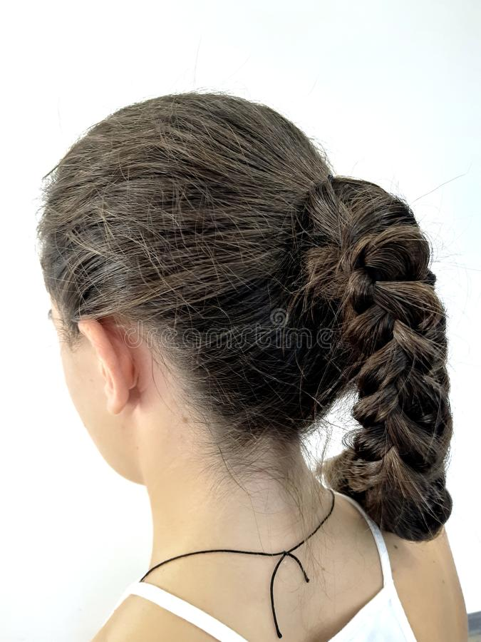 Hairstyle on long hair, braiding stock images