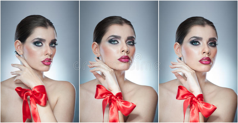 Hairstyle and Make up - beautiful female art portrait with red ribbon. Elegance. Genuine Natural brunette with ribbon - studio. Shot. Portrait of a attractive stock image