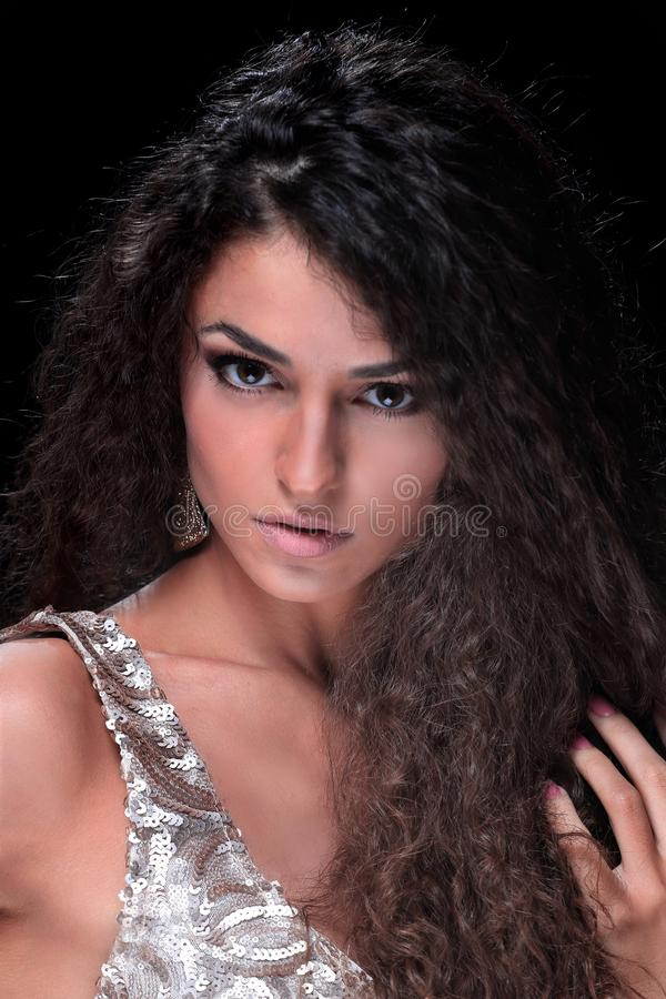 Hairstyle wavy curls. Beautiful sensual young woman with long curly hair and dark fashion makeup stock photos