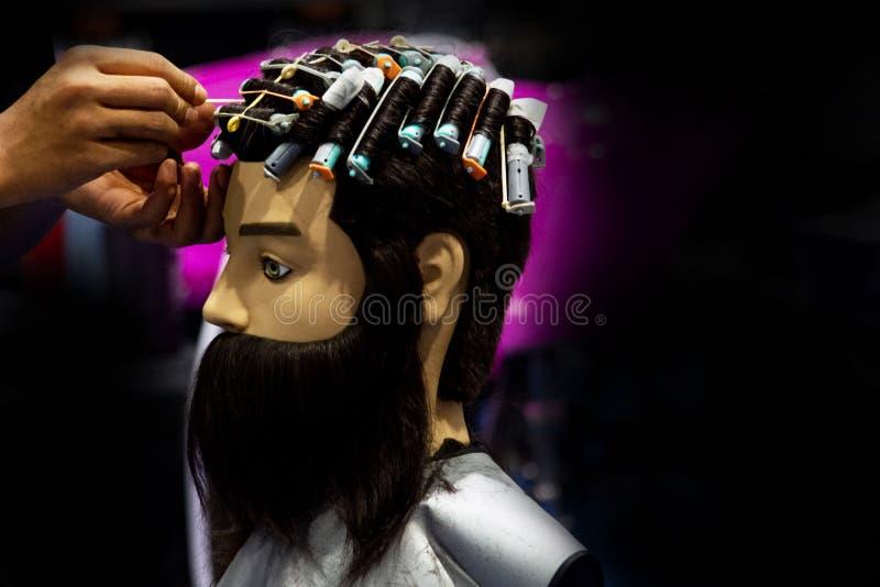 Hairstyles on dummy head of hair salon stock photos