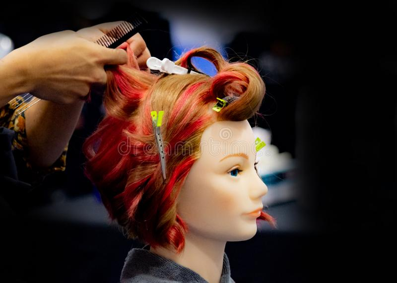 Hairstyles on dummy head of hair salon stock images