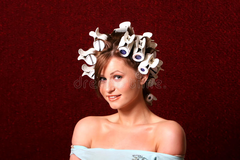 Hairstyling with hair rollers royalty free stock images