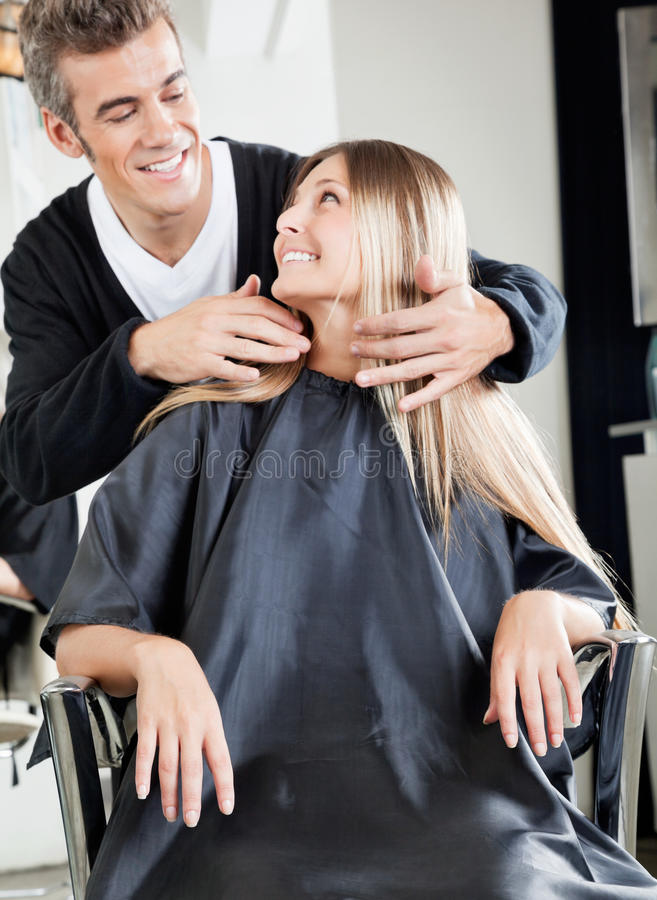 professional male hairstylist attending female client in beauty salon - Professional Hairstylist