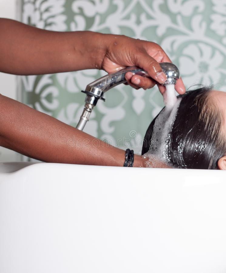 Hairwash in beaty salon. Parlour, care, style, makeup royalty free stock photography