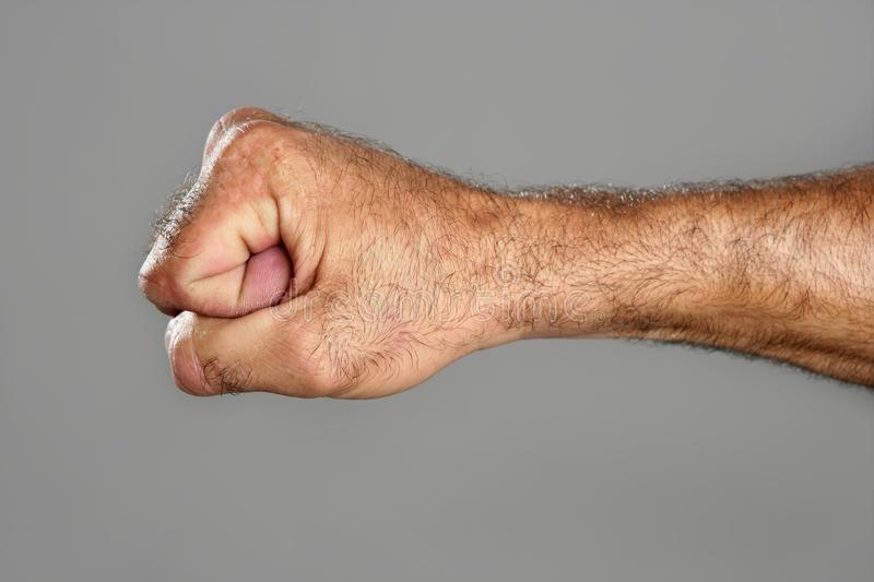 Download Hairy Man Fist Closeup Expression Over Gray Stock Photo - Image: 11786642