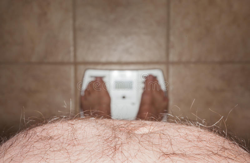 Download Hairy Man Stomach Overhangs Feet On Scales Stock Photo - Image: 23861854