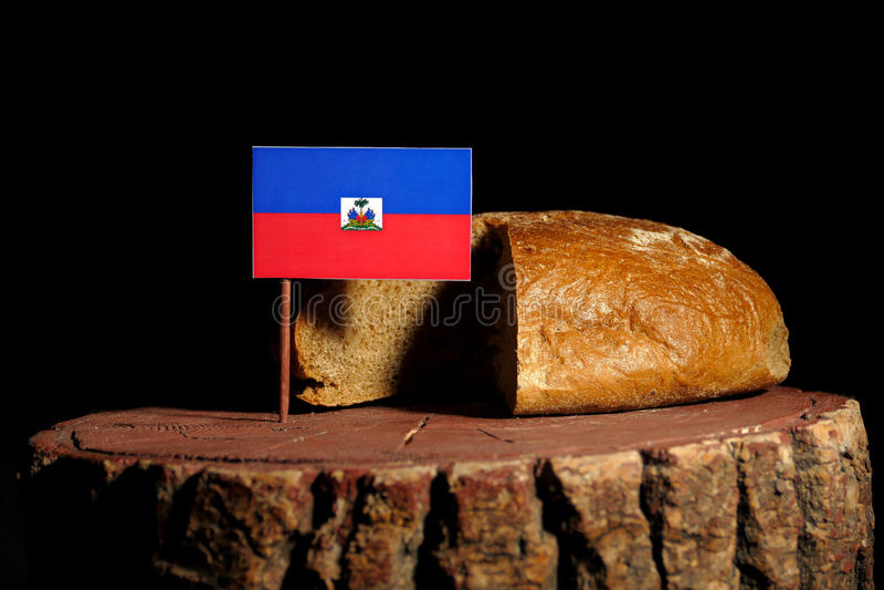 Haitańska flaga na fiszorku z chlebem fotografia royalty free