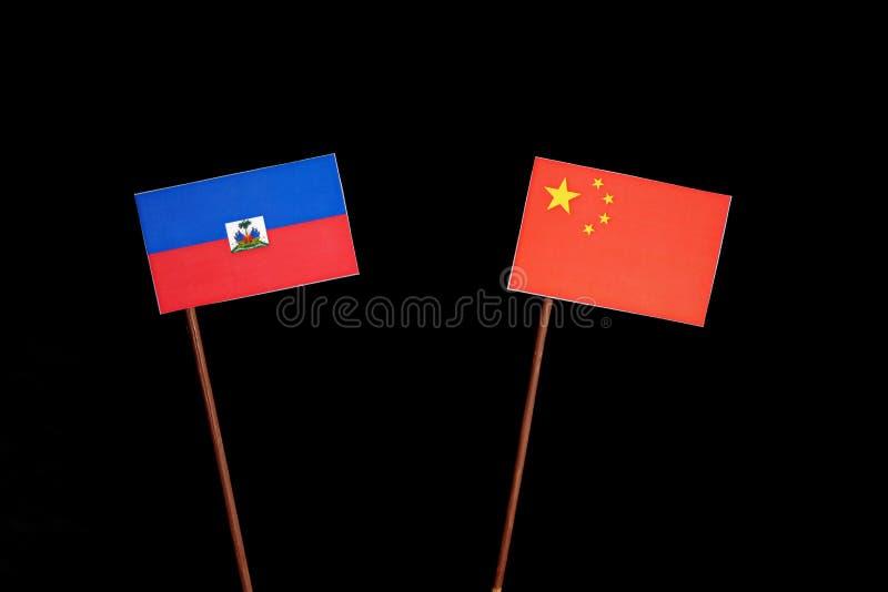 Haitańska flaga z chińczyk flaga na czerni zdjęcie royalty free