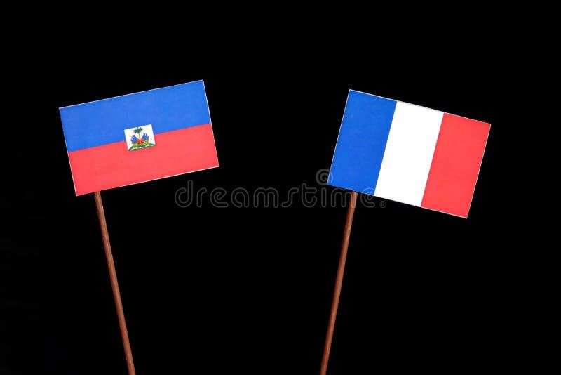 Haitańska flaga z francuz flaga na czerni fotografia stock