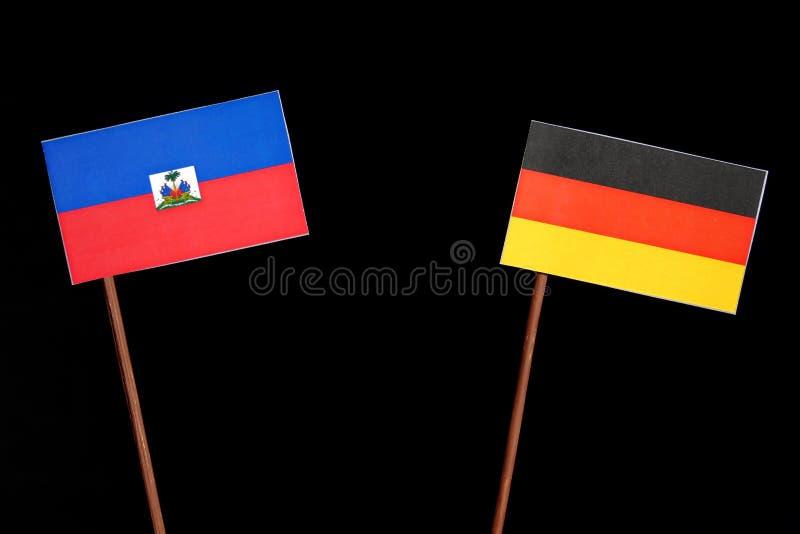 Haitańska flaga z niemiec flaga na czerni zdjęcia royalty free