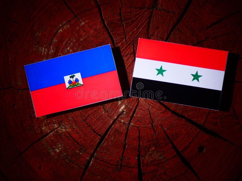 Haitańska flaga z syryjczyk flaga na drzewnym fiszorku fotografia stock