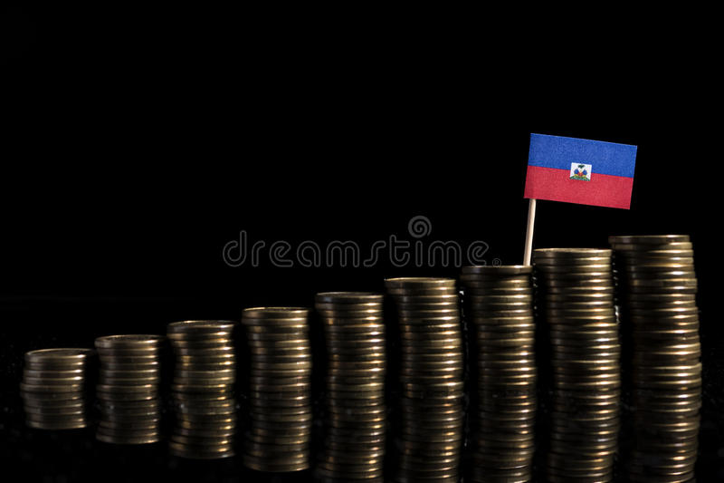 Haitańska flaga z udziałem monety na czerni obraz stock