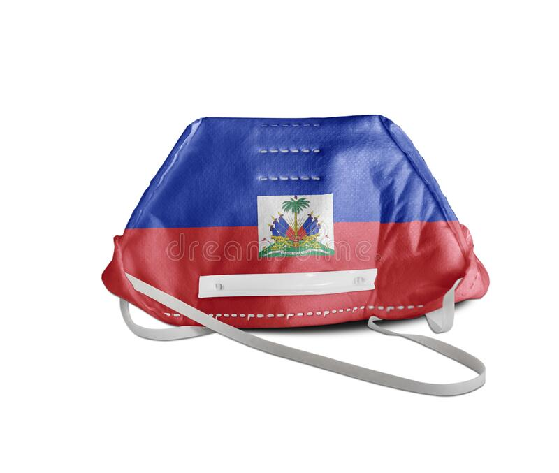Haiti flag on anti pollution mask medical protection. Close up stock photography