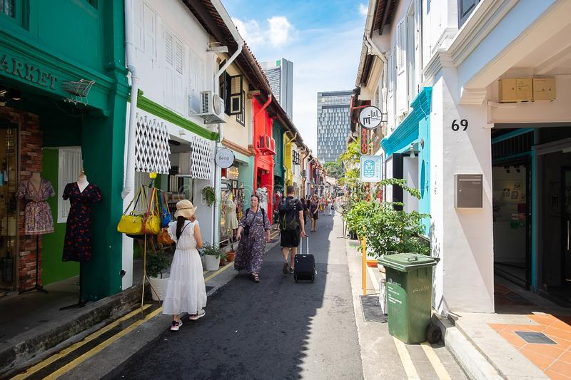 Haji Lane is in the Kampong Glam neighbourhood of Singapore. Young people frequent the shophouses along this lane for the stock images
