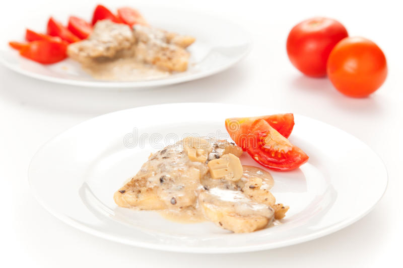 Hake fillets with cheese sauce and mushrooms stock photo