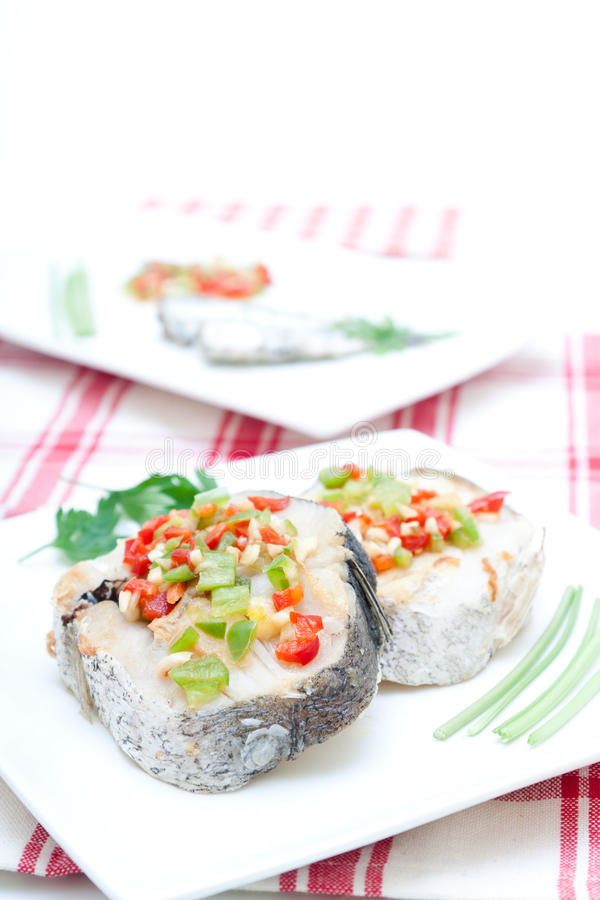 Hake fillets with peppers royalty free stock photos