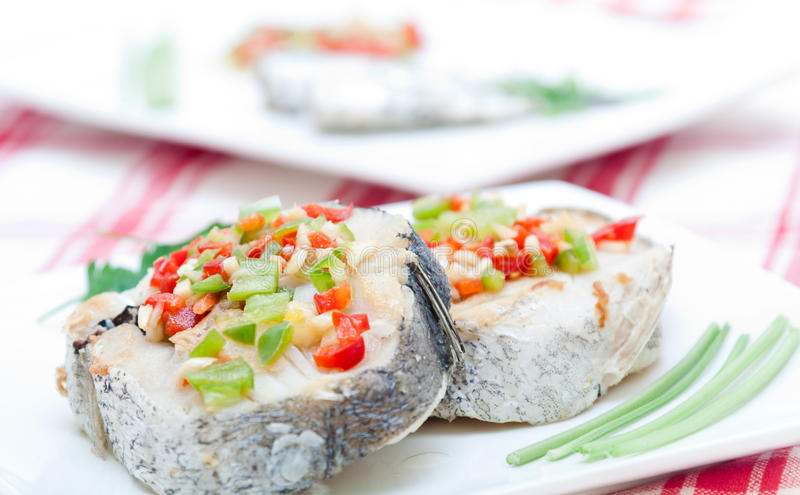Hake fillets with peppers stock image