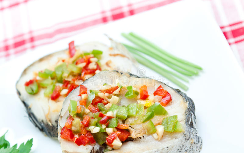 Hake fillets with peppers royalty free stock image