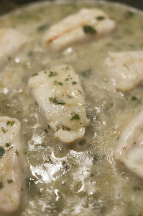 Hake in green sauce royalty free stock photography