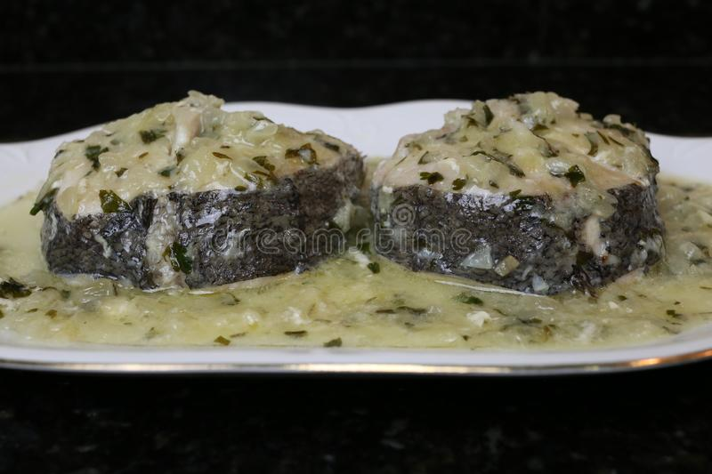 Hake in green sauce a very popular fish dish royalty free stock image
