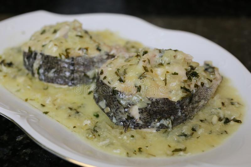Hake in green sauce a very popular fish dish stock images