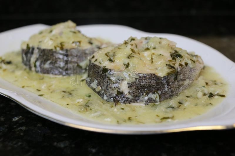 Hake in green sauce a very popular fish dish stock image