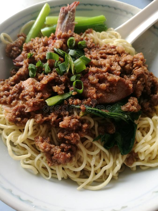 Hakka Noodle Tai Bou Mee. Hakka style dry springy noodle served with minced pork stock photo