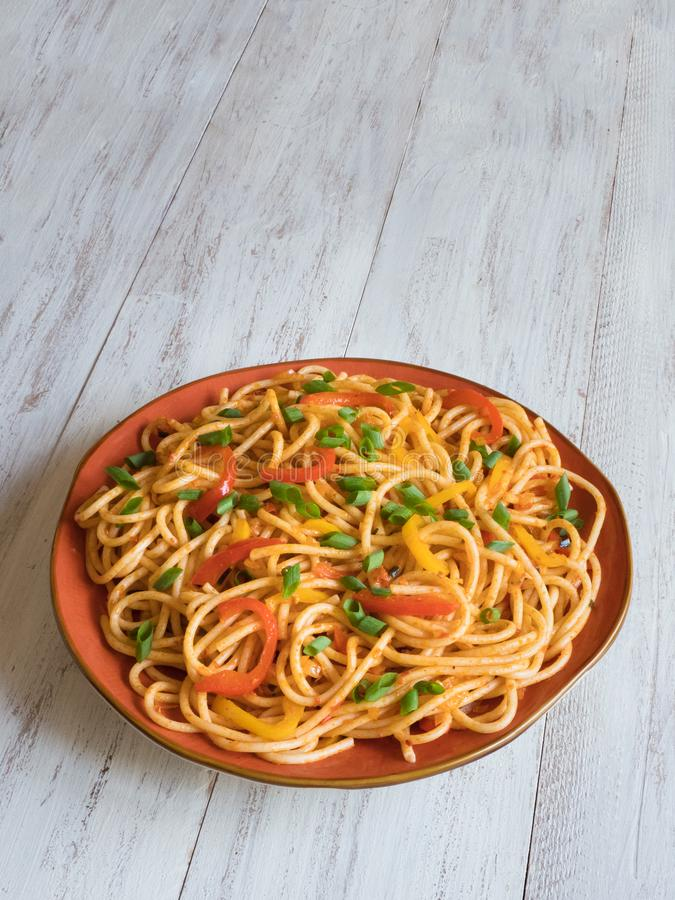 Hakka Noodles is a popular Indo-Chinese recipes. Schezwan Noodles with vegetables in a plate. Top view royalty free stock images