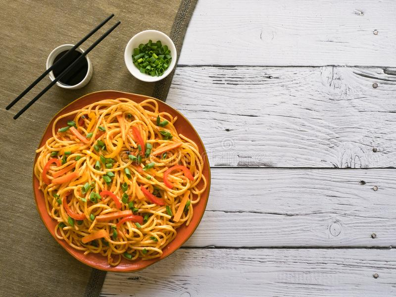 Hakka Noodles is a popular Indo-Chinese recipes. Schezwan Noodles with vegetables in a plate. Top view royalty free stock photo